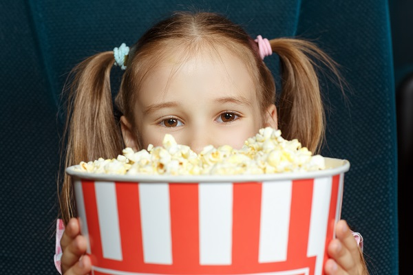 Adorable little girl with popcorn